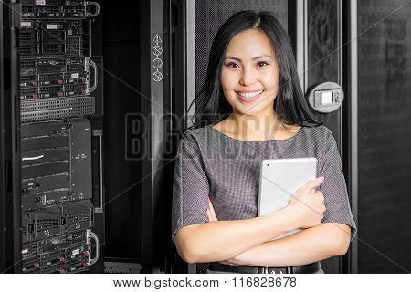 Engineer businesswoman in network server room