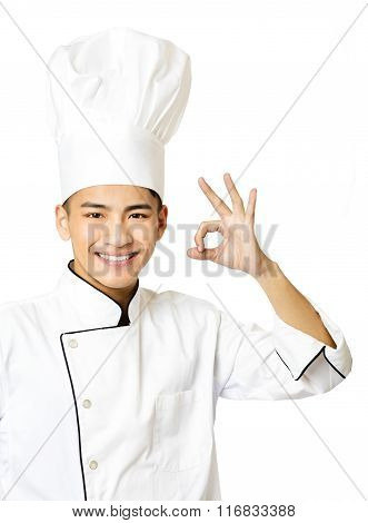 Young Chef With  Ok  Gesture Isolated On White
