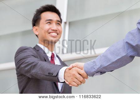 Businessman Making Handshake