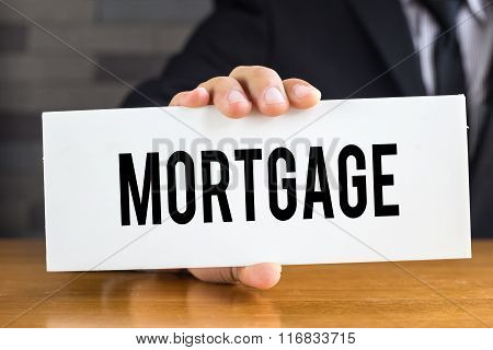 Mortgage, Message On White Card And Hold By Businessman
