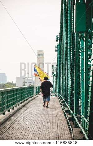 One Man Walk On Walking Way Beside Memorial Bridge