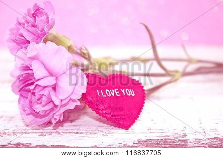 Pink Carnation Flowers With Heart On Rustic White Wooden Table. Valentine's Day And Mother's Day Bac