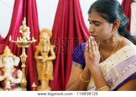 Woman hand folded during praying events. Traditional Indian Hindus ear piercing ceremony. India special rituals.