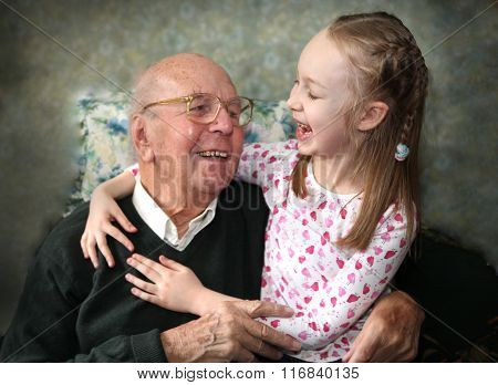 95 years old grandfather with granddaughter playing together