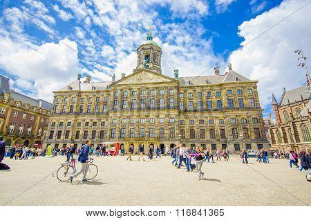 Amsterdam, Netherlands - July 10, 2015: Royal Palace on a beautiful sunny day, majestic European arc