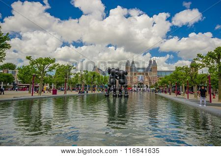 Amsterdam, Netherlands - July 10, 2015: Large water fountain located in front of the National Museum