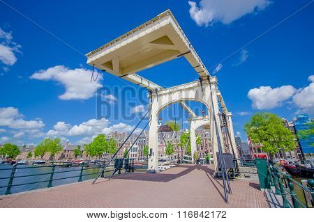 Amsterdam, Netherlands - July 10, 2015: Old metal bridge with beautiful design, stretching across on