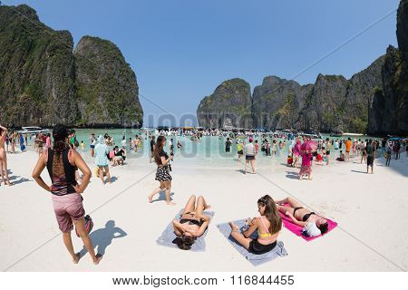 PHI PHI ISLANDS, THAILAND - CIRCA FEBRUARY, 2015: Tourists relax on the beach of Maya Bay on Phi Phi Leh island. It starred the movie The Beach with the actor Leonardo DiCaprio. Taken with a fisheye