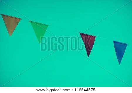Colorful Of Triangle Flag On Dark Green  Background. Vintage Tone Process