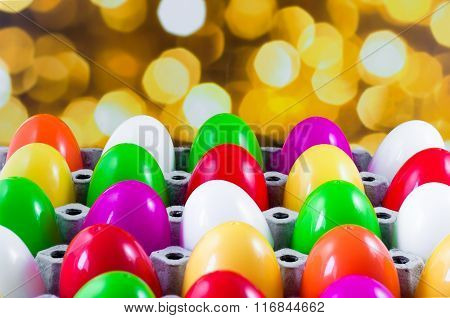 Fancy Or Colorful Of Egg In Spawn Box With Yellow Bokeh Light Background. Soft Focus