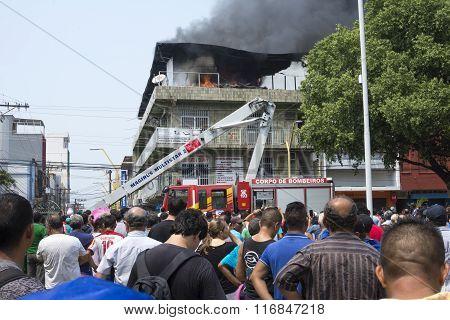 People Watch Building Burn In Manaus