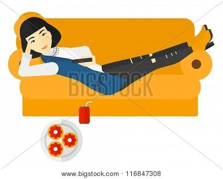 Woman lying on sofa with junk food.