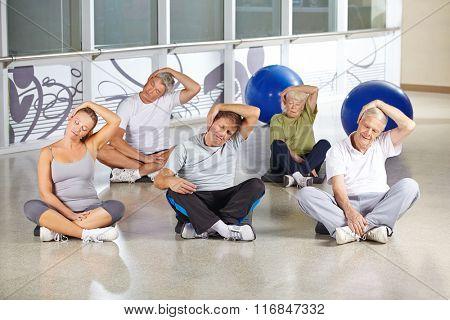 Senior people loosing nape during back training in gym