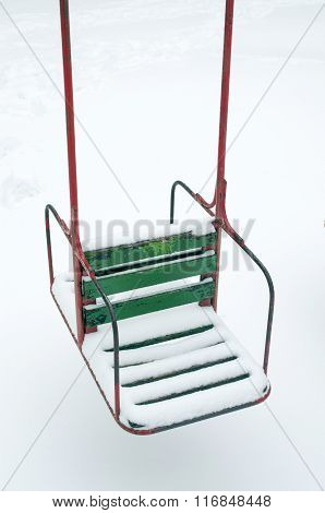 Snow Green Swing On The Beach In Winter