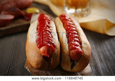 Hot dogs on wooden background closeup