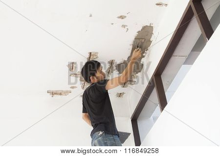 Plasterer At Ceiling Renovation Decoration