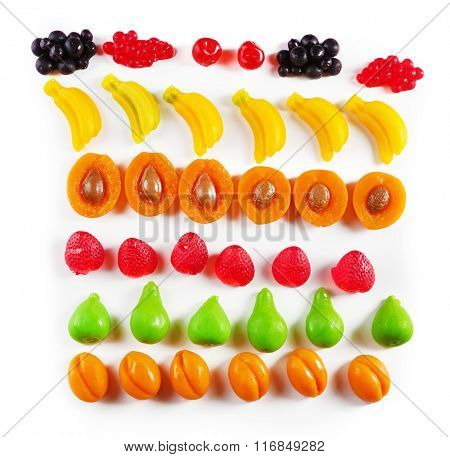 Set of lined colourful fruit jelly sweets, isolated on white