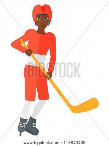 Ice-hockey player with stick.