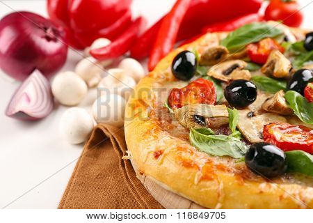 Delicious tasty pizza with vegetables on cutting board