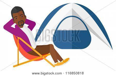 Man sitting in folding chair.