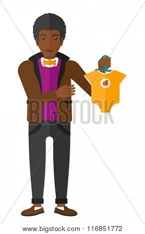 Man holding clothes for baby.