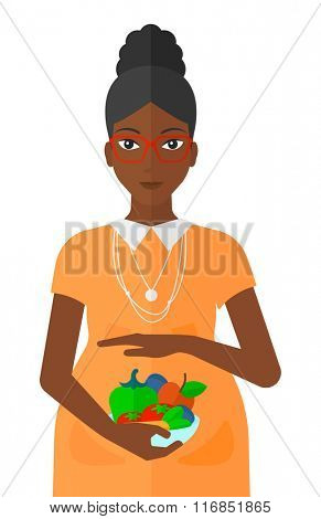 Pregnant woman with vegetables.