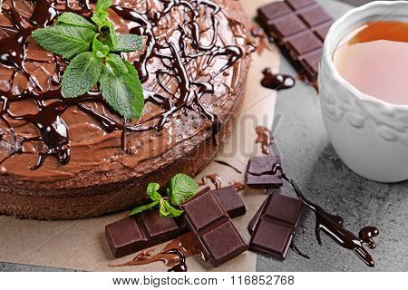 Decorated chocolate pie with tea cup, closeup