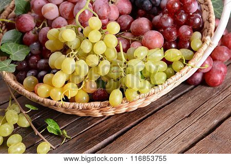 Grape in basket on wooden table