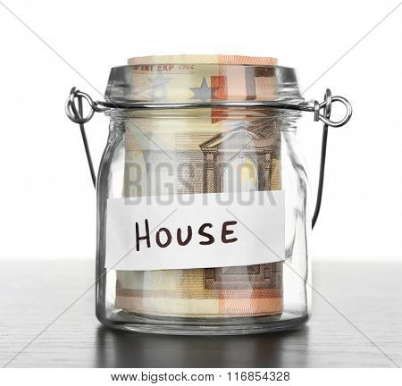 Jar for savings full of banknotes