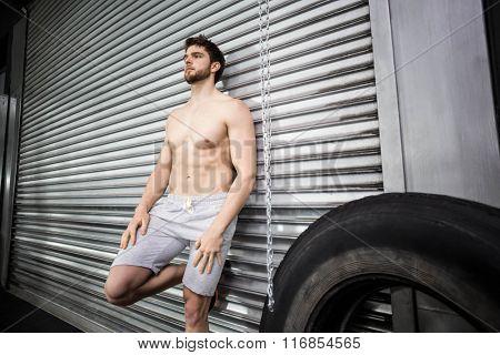 Shirtless fit man posing at crossfit gym