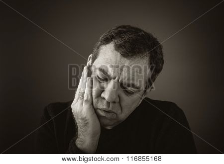 Man with a toothache tooth pain