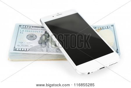 Smart phone on a stack of dollar banknotes, isolated on white. Internet earning concept