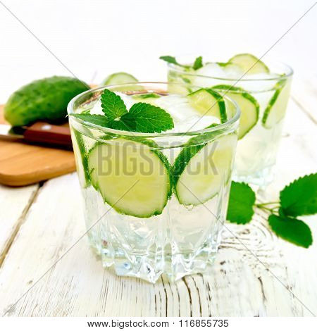 Lemonade with cucumber and mint in two glassful on board