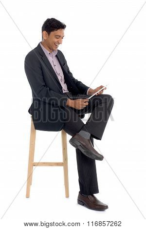 Asian Business Male Sitting Using Tablet Computer