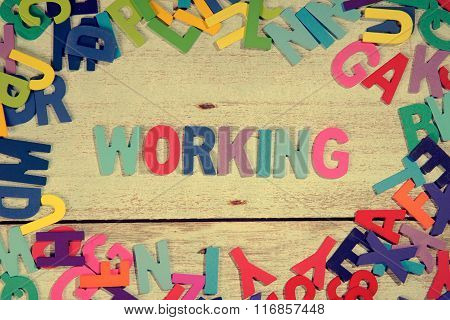 Working Word Block Concept Photo On Plank Wood