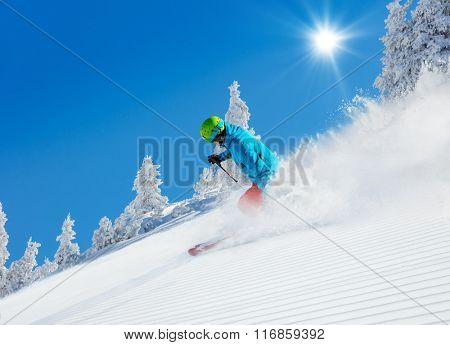 Man skier running downhill