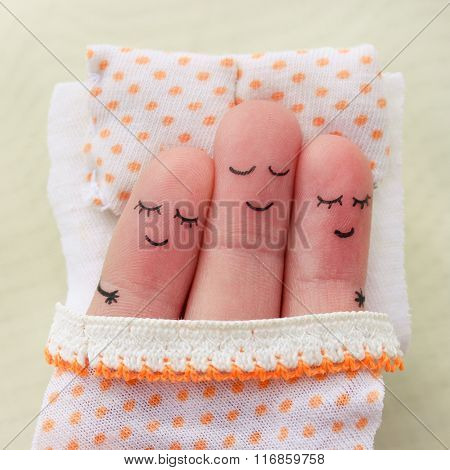 Finger art. Happy man sleeps with two women.