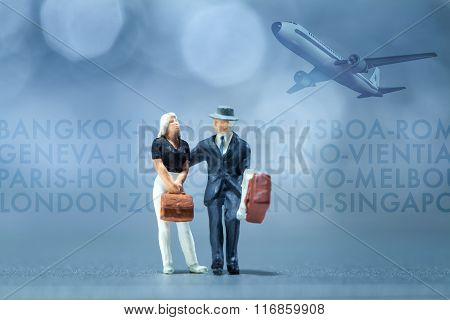 Miniature people - business people waiting in the airport lobby