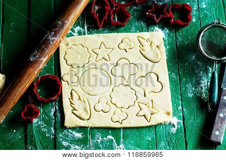Process of baking cookies at home. Fresh dough ready for baking on rustic green wooden background. D