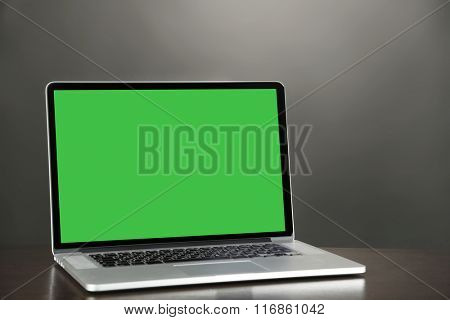Modern laptop on table, close up