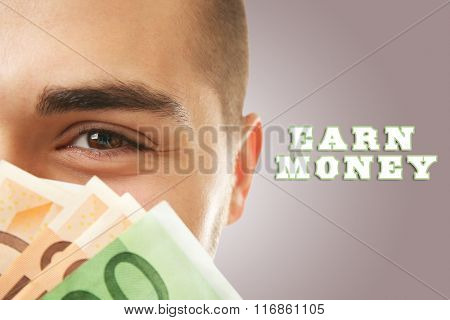 Man holding money on brown background