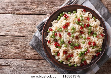 Couscous Salad With Green Peas And Pomegranate. Horizontal Top View