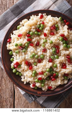 Couscous Salad With Peas And Pomegranate Closeup. Vertical Top View
