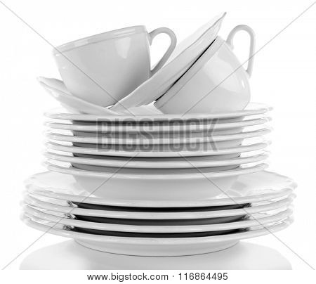 Stack of plates and cups, isolated on white