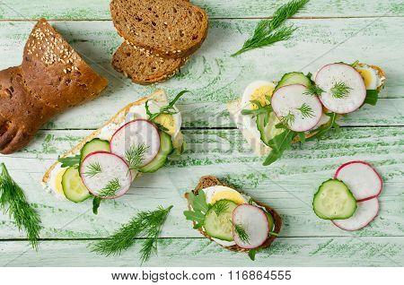 Sandwiches With Egg, Radish, Cucumber And Arugula