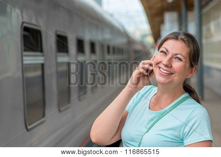Horizontal Portrait Of The Girl With The Phone Near The Train