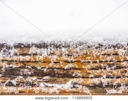 Wooden board, timber or plank covered with snow