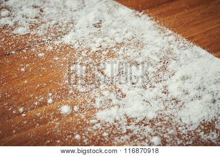 Flour On Wooden Table