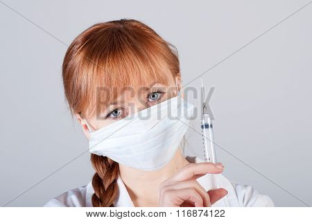 Closeup of a female doctor with syringe