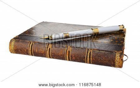 Fountain pen and old book